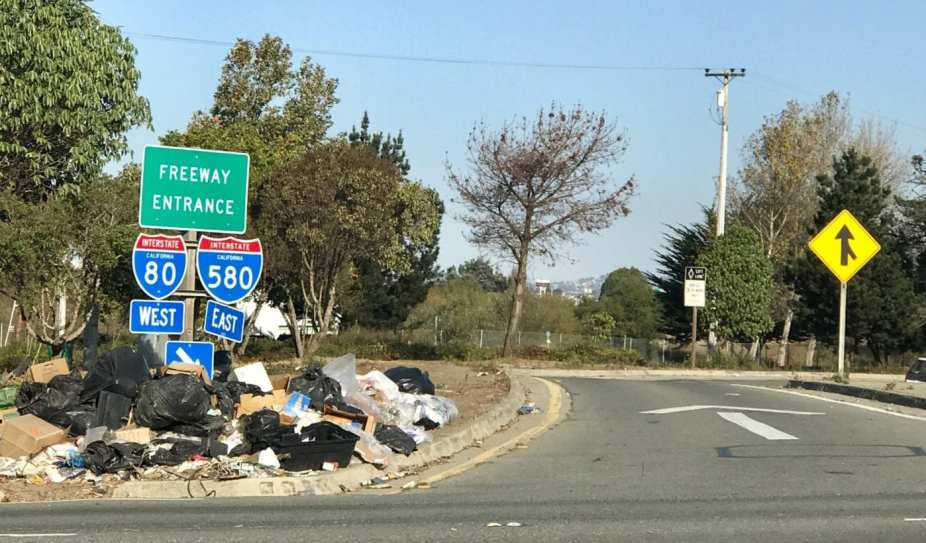 Trash collecting on Caltrans I-80/I-580 on-ramp, Berkeley, CA.