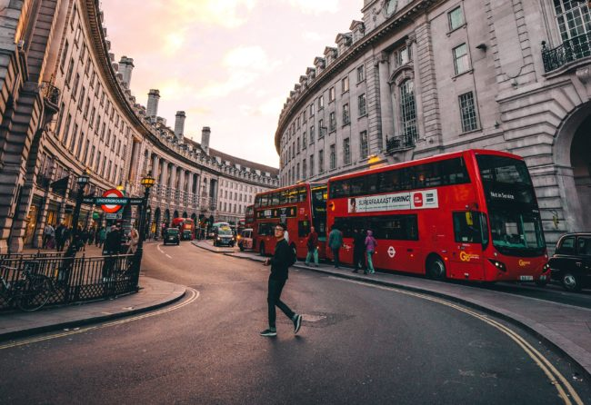 Outdoor advertising on London busses, Photo by Ryan Tang on Unsplash