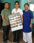 Babita Bajimaya, Emergency Encharge, and Dr. Shakuntala Gupta, Lumbini Zonal Hospital, Rupandehi, being handed over Poster