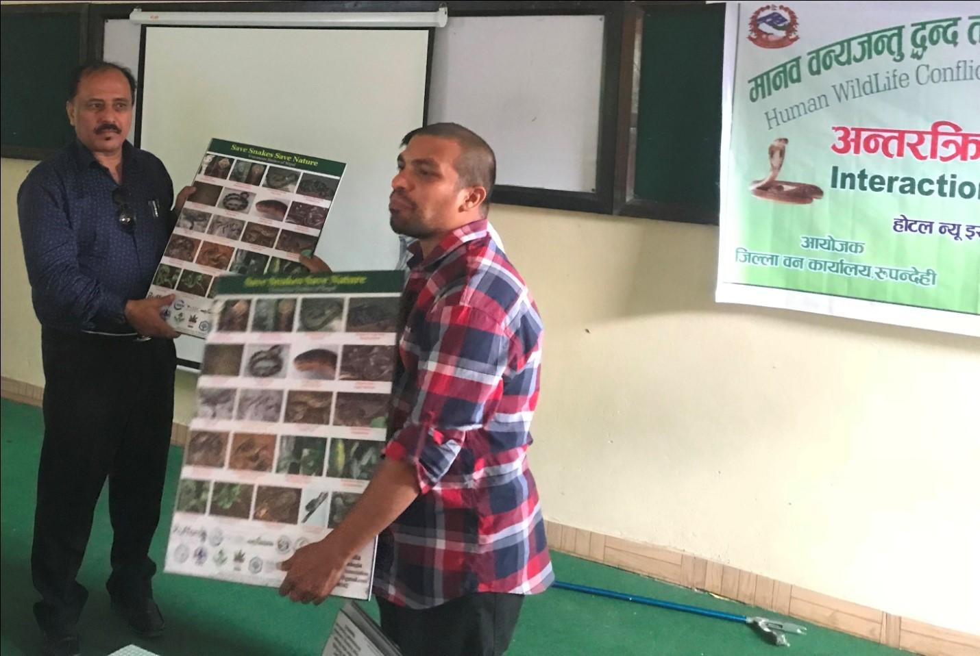 Romraj Lamichhane, District Forest Officer (DFO), Rupandehi, being handed over Five Mounted Laminated Framed Poster at the district level workshop.