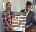 Surya Kant Sigdel, Secretary, Ministry of Industry, Tourism, Forest and Environment, Province No. 5, being handed over the Mounted Laminated Framed Poster.