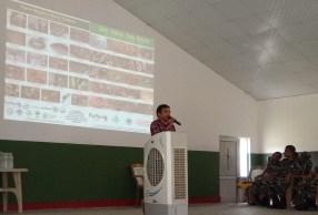 Mr. Kamal Devkota showing the differences between venomous and non-venomous snakes