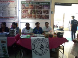 Dr. Chhabilal Thapa and Mr. Kamal Devkota in the stall with the volunteers