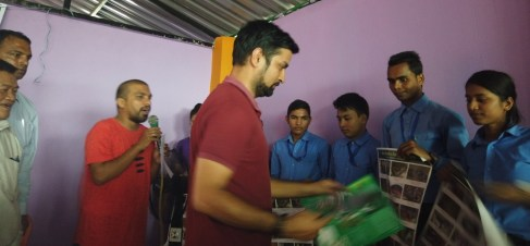Dr. Amod Ghimre distributing brochures and posters to the participants