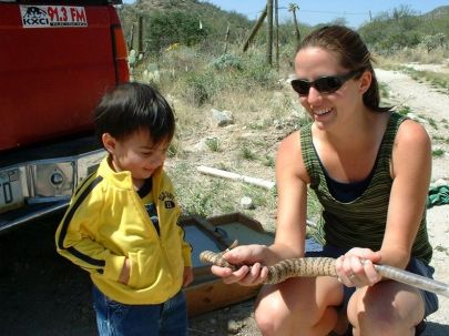 Melissa showing her nephew Angelo a tiger rattlesnake, photographed by Jeff Amarello.