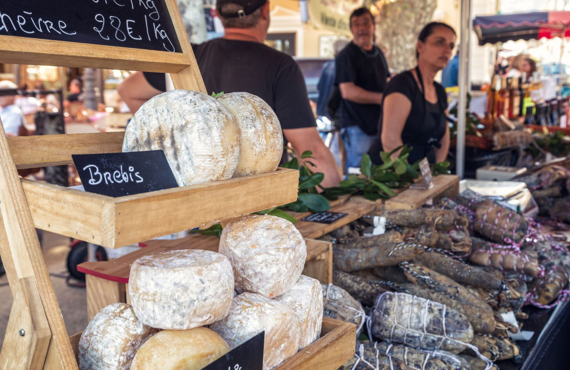 L'Ile Rousse, Corsica - 30th September 2018. Locally made cheeses and cured meats are displayed for sale at an artisan fair in L'Ile Rousse in the Balagne region of Corsica