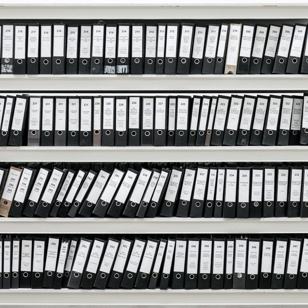 Shelves full of number binders