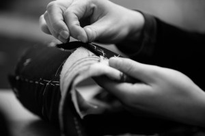 Black and white image of hand sewing custom clothing.