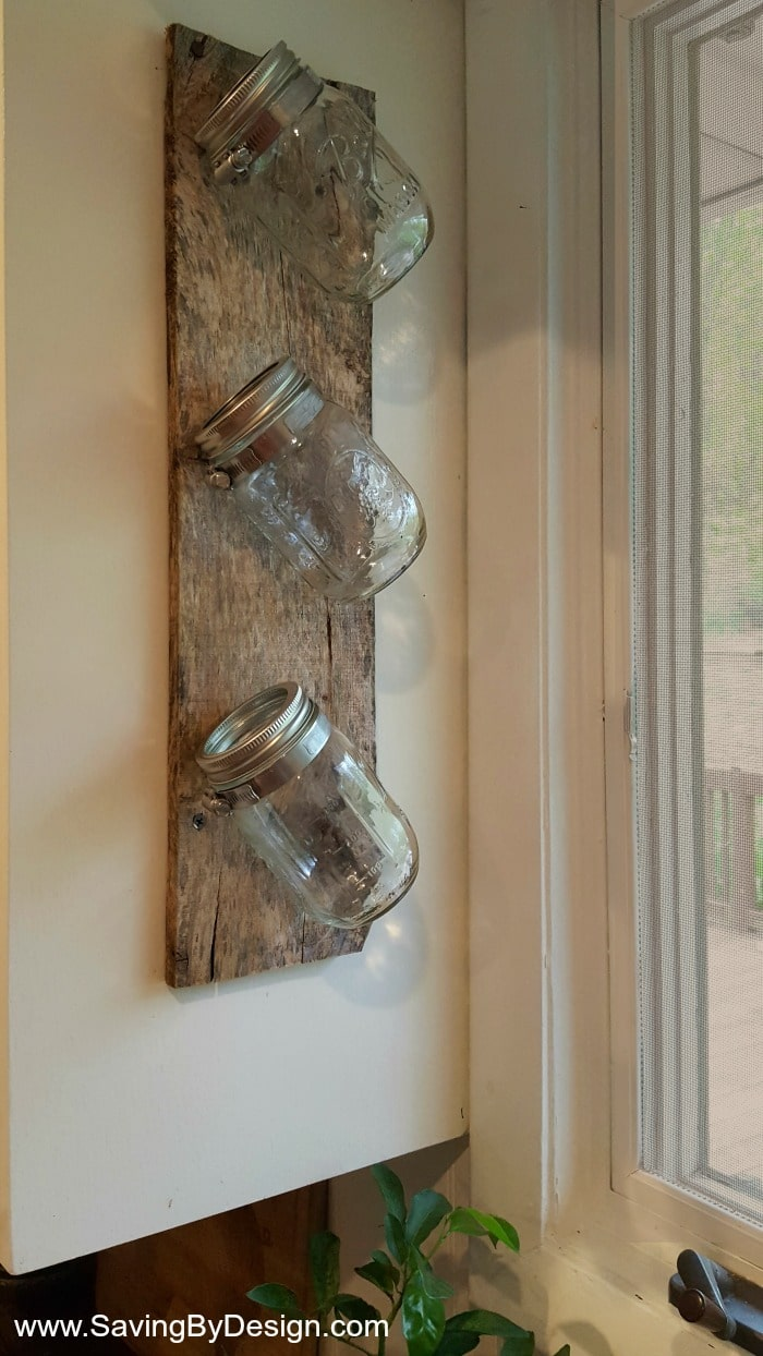 Mason jars, clamps, and a piece of wood are all you need to create your very own indoor wall mounted herb garden to enjoy fresh herbs year round!