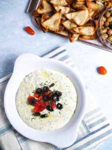 cheese dip with tomatoes and olives