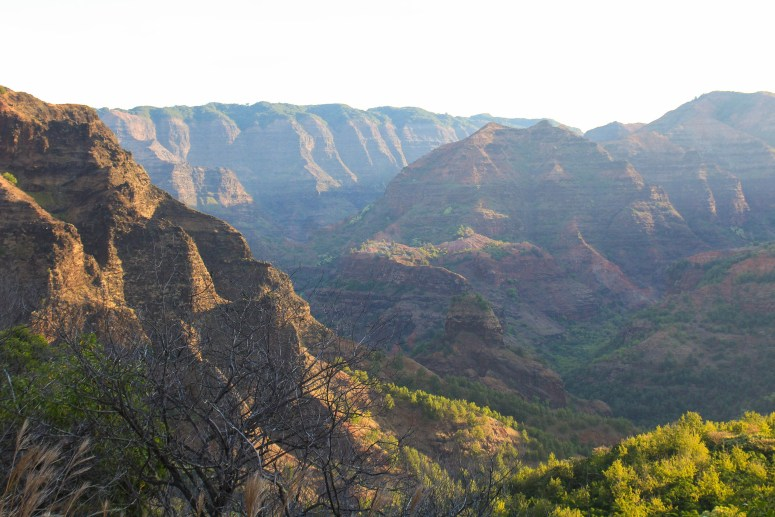 Backpacking Waimea Canyon Kauai hiking up the canyon at sunrise