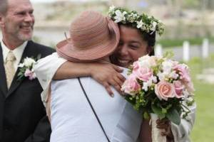 Claire hugging a friend at her wedding