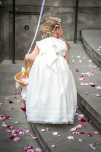 Flower Girl with pink flowers from behind