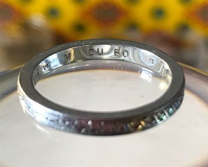 Claire's wedding ring with inscription