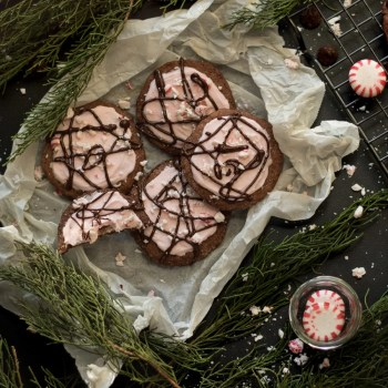 Chocolate Peppermint Cookies: a chocolate cookie topped with fluffy peppermint icing, crushed peppermint, and a drizzle of chocolate. | www.savortheflavour.com