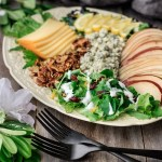 salad on a yellow platter with two forks