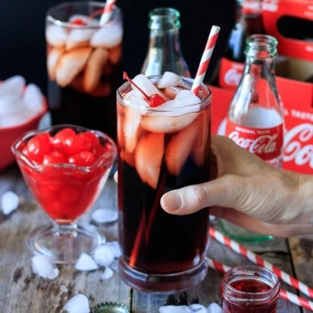 Roy Rogers Mocktail: an easy, non alcoholic recipe that is both fun to make and drink for your children. It only takes 4 ingredients: cola, grenadine, maraschino cherries, and ice. This popular drink is commonly served along side a Shirley Temple to please both the boys and the girls at any party. | www.savortheflavour.com #royrogers #mocktail #coke #grenadine #recipe