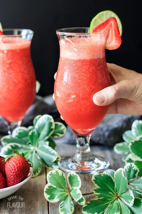 person holding a virgin strawberry daiquiri
