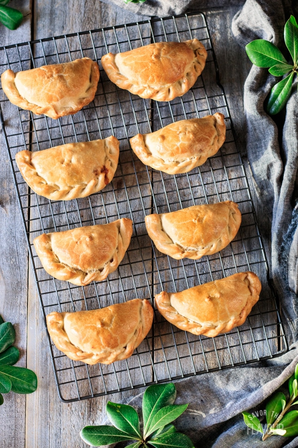baked chicken empanadas on a wire cooling rack