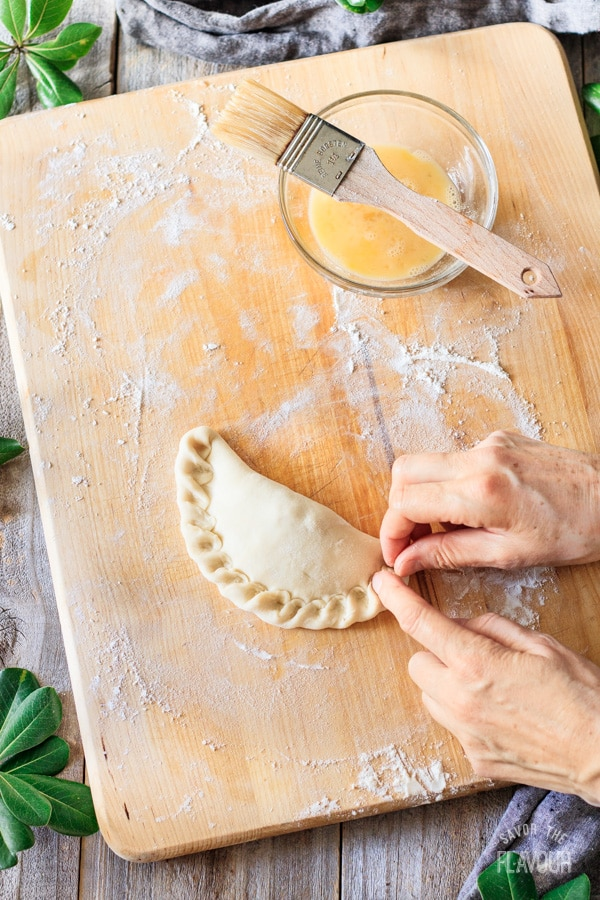 crimping one of the baked chicken empanadas