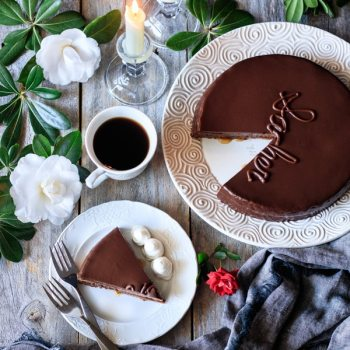 slice of sachertorte on a plate with forks