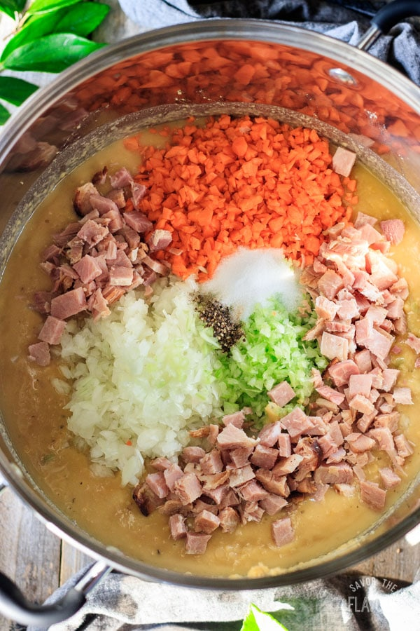 adding ham and veggies to split pea soup