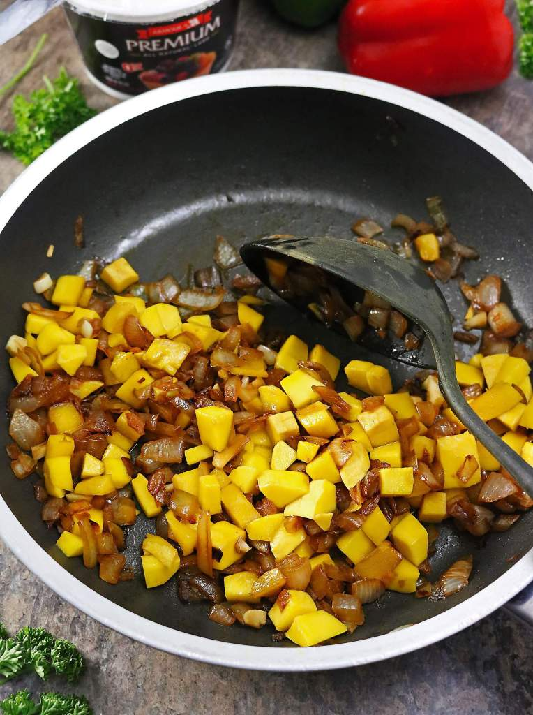 Mangoes, Ginger, Garlic, and Onions Sauteing