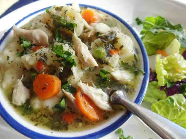 Southern Chicken and Dumplings Recipe in bowl with spoon