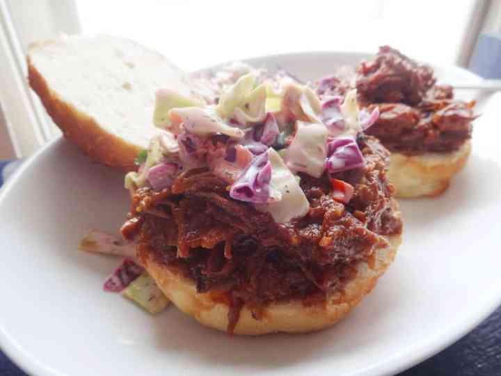 BBQ pulled pork in the slow cooker on buns with slaw