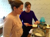 Jodi and Carolyne check the cookie dough - photo - Karen Anderson