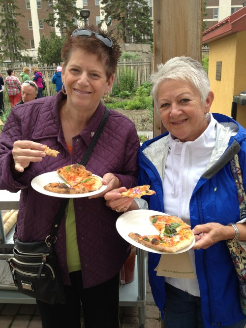 Eileen Lawrence and Marjorie Potts loving their Margarita pizzas fresh from the oven photo - Karen Anderson