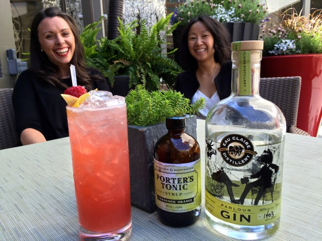 Katie Mayer and Christina Mah in the poolside garden at the Hotel Arts talking about Gnome Come Home's local ingredients - photo - Karen Anderson