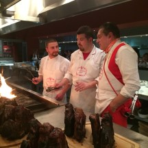 chef Talyor Gant of Mercato West cooking with Dario Cecchini and son-in-law
