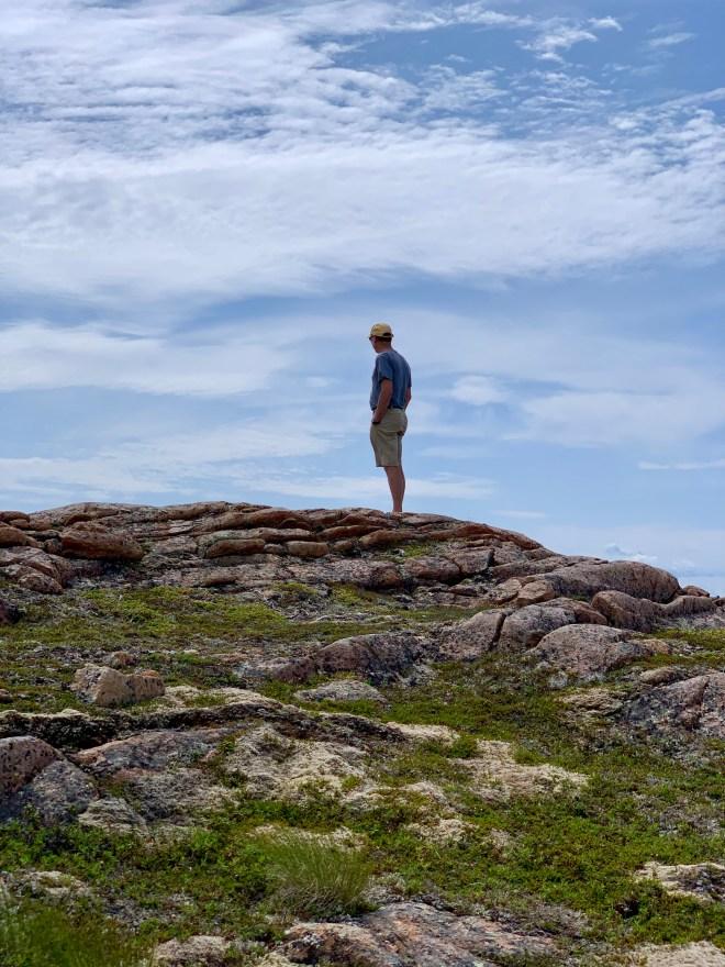 Hiker on a trail near Bridge Studio