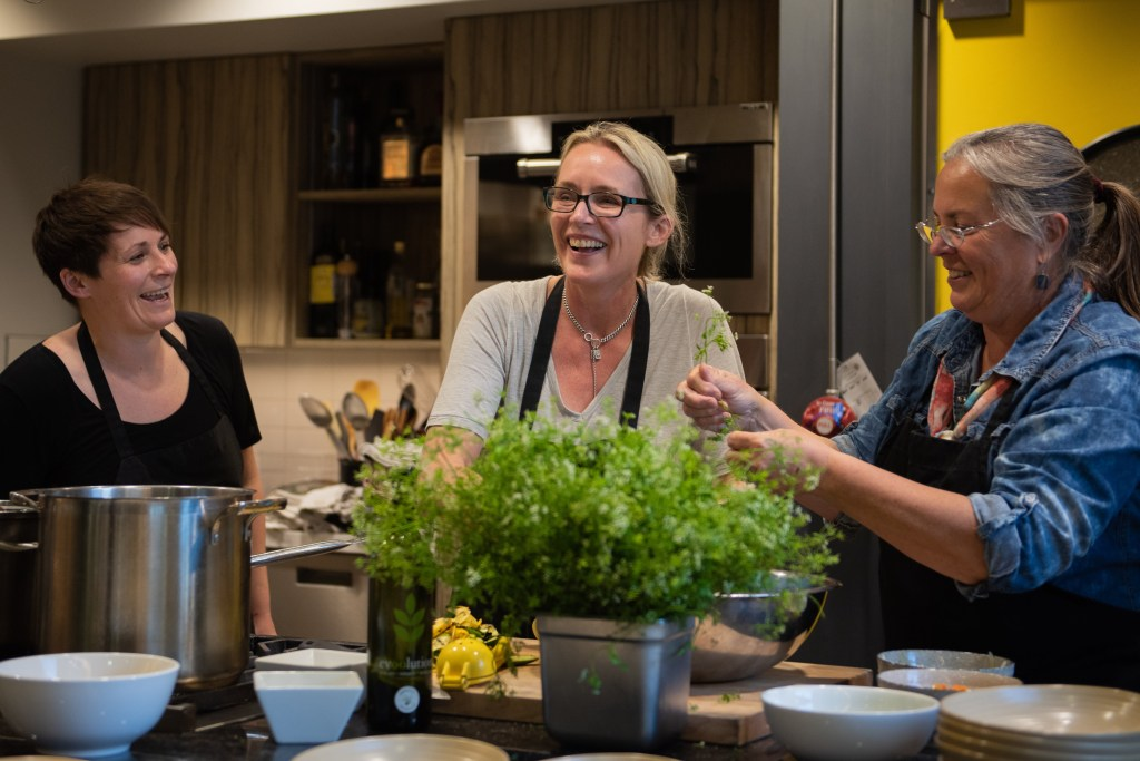 Kathryn Joel teaching with Elyse Chatterton and Tam Anderson at Get Cooking in Edmonton