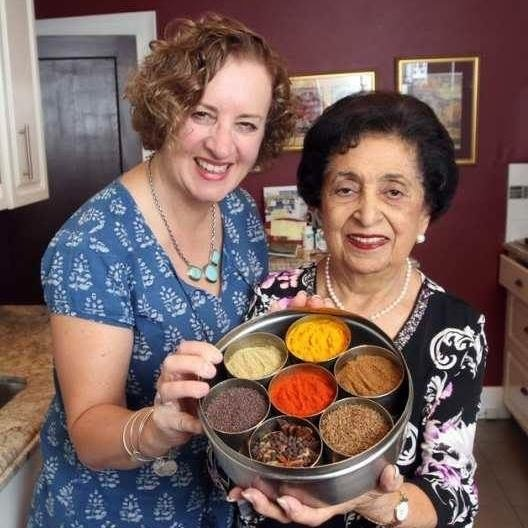 Karen Anderson and Noorbanu Nimji with a masala daba spice box