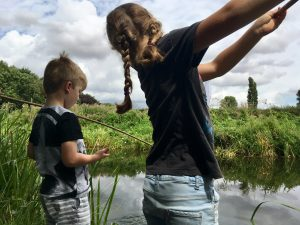Evie and Jack try out their fishing nets