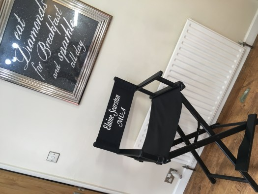 Client chair and framed inspirational quote on the wall