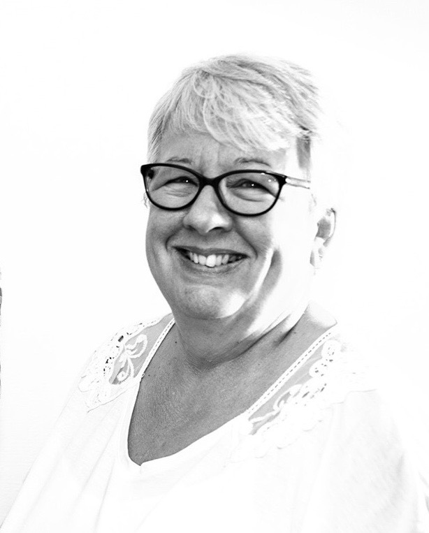 A black and white image of Gill Hinton, founder of Carers' Education