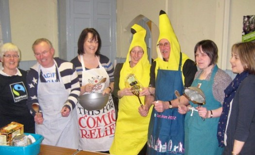 A group of seven people having fun at a Fair Trade event
