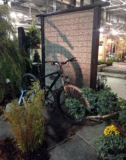 bike and fence at Canada Blooms