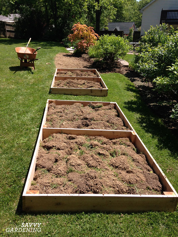 If you dug up sod to make room for a raised bed, flip the pieces upside-down and use them to fill the bottom.