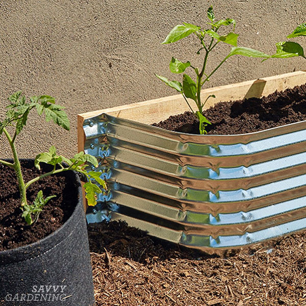 a window well raised bed and a fabric container