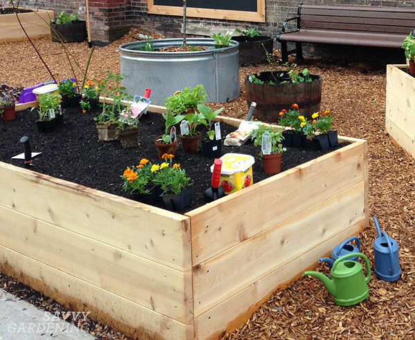 three different types of raised beds in a children's garden