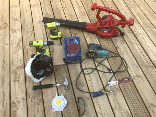 tools and material for sanding and repairing a deck