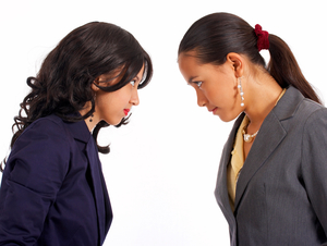 Two Girls Looking Angrily At Each Other