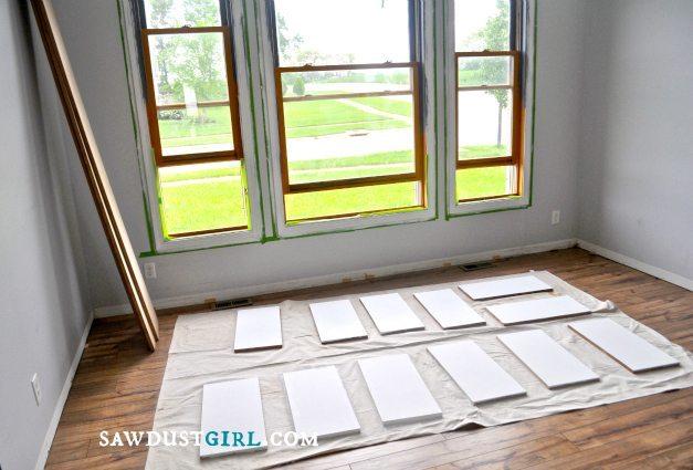 painting cabinet parts before assembling bookshelves