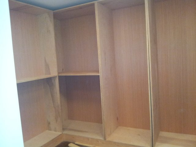 Building cabinets in walk in closet