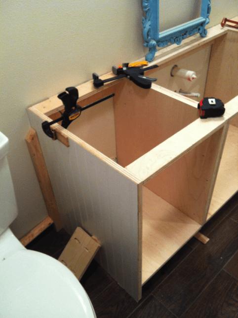 installing DIY cabinets in bathroom