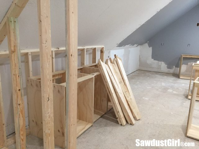Building a wall behind cabinets to position them correctly in the room.